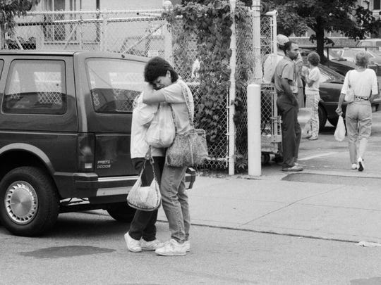 Two women hugged outside of the STandard Gravure building