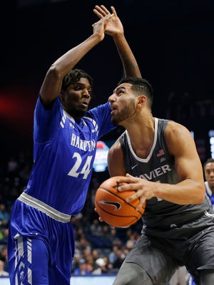 Xavier Musketeers forward Kerem Kanter (11) looks for a shot under Hampton Pirates forward Austin Colbert (24) in the second half of the NCAA men's basketball game between the Xavier Musketeers and the Hampton Pirates at the Cintas Center in Cincinnati on Monday, Nov. 20, 2017. The Musketeers took a 96-60 win over Hampton, advancing to 4-0 on the season.