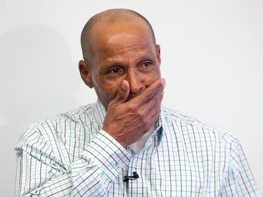Louis Taylor, 59, gets emotional during a news conference