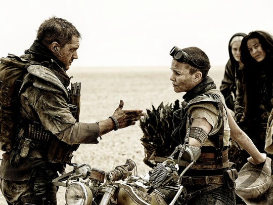 """Max (Tom Hardy) and Furiosa (Charlize Theron) team up in """"Mad Max: Fury Road."""""""