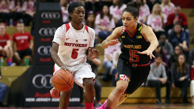 Rutgers guard Shrita Parker is pressured by Maryland's Chloe Pavlech during Sunday's Big Ten battle at the RAC.