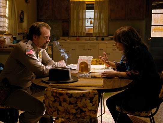 This image released by Netflix shows David Harbour,