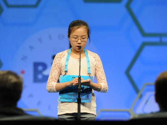 "Raphael Kim, 12, of Newark, Del., spells the word ""almoner"" correctly during the 2016 Scripps National Spelling Bee at the Gaylord National Resort and Convention Center."