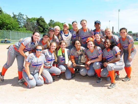 Garden City's varsity girls softball team celebrates