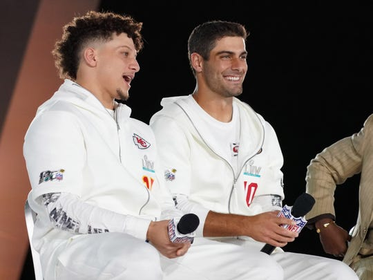 Jan 27, 2020; Miami, FL, USA; Kansas City Chiefs quarterback Patrick Mahomes (left) and San Francisco 49ers quarterback Jimmy Garoppolo (right) are interviewed on stage during Super Bowl LIV Opening Night at Marlins Park.  Mandatory Credit: Kirby Lee-USA TODAY Sports