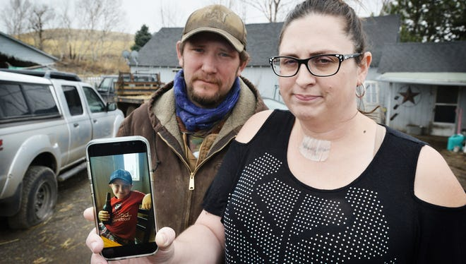 Scott Hinkle, left, and Sara Hebard, both of Pilot Rock, Oregon, lost their son, Liam Flanagan, 8, pictured in the cell phone photo.