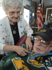 In this 2010 file photo, Mardelle Ingman, 77, puts the Medal of Honor on her husband Einar Ingman Jr. at the Golden Age Living Center in Tomahawk. Einar passed away Sept. 9. Mardelle passed away in April 2011.