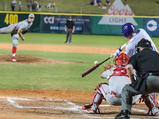 With Jack Burk on the mound and Handsome Monica behind the plate for UL, LSU catcher Michael Papierski strikes out Tuesday night during the annual Wally Pontiff Classic at Zephyr Field.