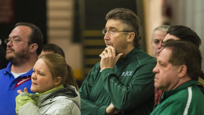 Rice coach Tim Rice watches his team play Champlain Valley during the continuation of the Division I high school girls semifinal at Patrick Gymnasium in March. Five days prior, Rice collapsed, and was revived, during the game in one of the year's biggest Vermont sports stories.