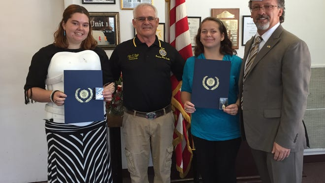 The American Legion held its annual Oratorical Speech Contest on Saturday in Albuquerque. Winners were alternate Paige Parkes, from left, District No. 7 Commander John Sterle, winner Naida Newling, and Department of NM Oratorical Chairman Clarence Ortega.