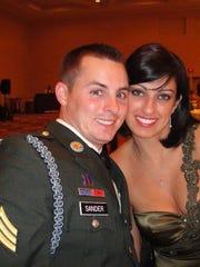 Kariny Sander, right, and her late husband Sgt. Scott Sander.