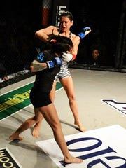 Kelsey Gollihar, 23, competes  in her first fight in