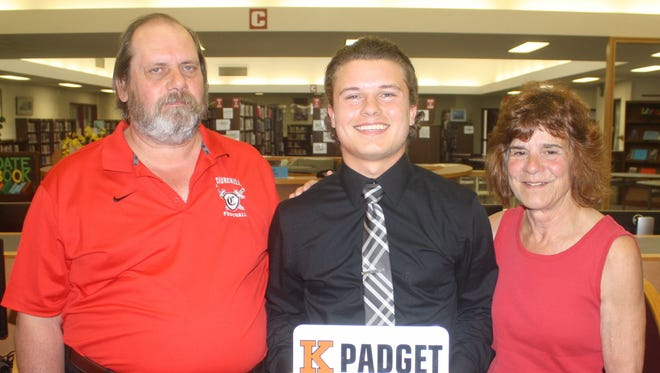 Pictured with Dylan Padget are his parents Bob and Lynn.