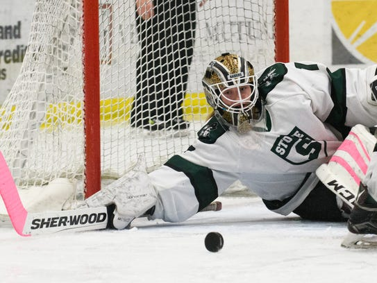 Stowe goalie Leo Clark (1) keeps an eye on the puck