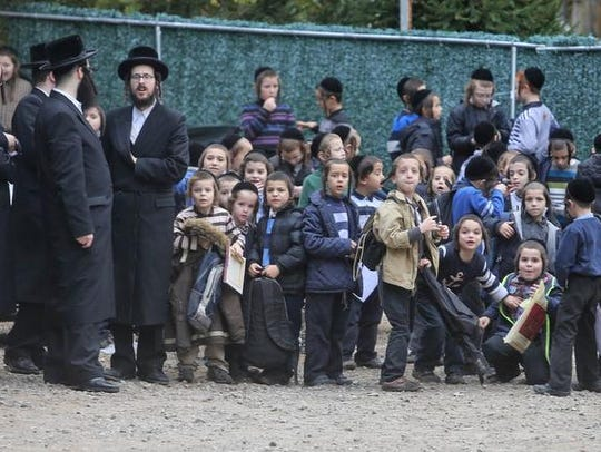 Children and adults outside a yeshiva on Highview Road