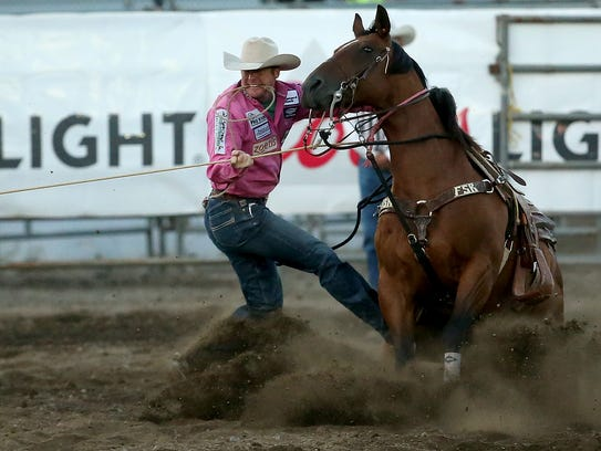 Tyson Durfey competes in the tie down roping event