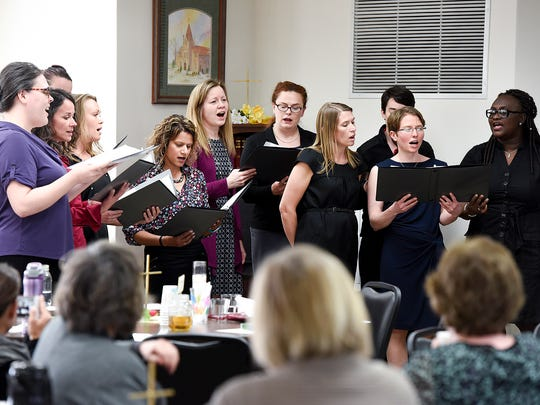 Mettekor members sing and share memories of group founder Mette Kirsch after her memorial service Friday, April 28, at the Trinity Lutheran Church in Sauk Rapids.