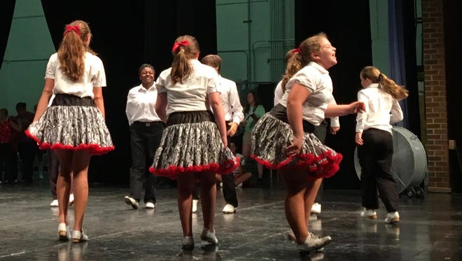 """The Peanut City Cloggers junior team, of Suffolk, performs its """"Southern Appalachian"""" routine at the """"Rally in the Valley"""" clogging competition at Robert E. Lee High School in Staunton, Va., on Saturday, July 22, 2017."""