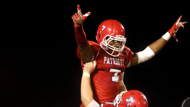 Oakland's Benji Arnette (67) lifts JaCoby Stevens (7) up into the air to celebrate Steven's touchdown against William Blount. Stevens has been named a finalist for the Class 6A Mr. Football Back Award.