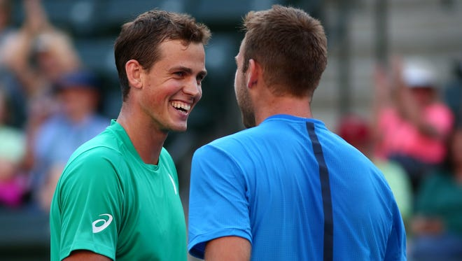 Vasek Pospisil of Canada (left) congratulates partner American Jack Sock (right) after the duo won a men's doubles quarterfinal match Thursday, March 17, 2016 against Philipp Kohlschreiber and Dominic Thiem at the BNP Paribas Open in Indian Wells, Calif. Sock and Pospisil won in straight sets 7-5 and 6-3.