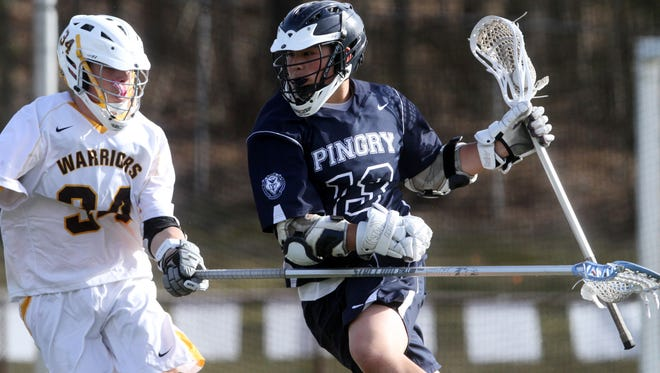 file photo Pingry?s senior attack Austin Chang drives on Watchung Hills? Dylan Lamson last season. On Wednesday, Chang recorded a hat trick, including the winning goal. Pingry's Austin Chang drives on Dylan Lamson of Watchung Hills, Thursday, April 16, 2015, in Warren, NJ.