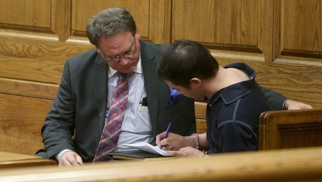 Mark Donahoe (left) goes over the plea form with Andrew Kim during a court appearance Monday in Judge Don Allen's courtroom at the J. Alexander Leech Criminal Justice Complex.