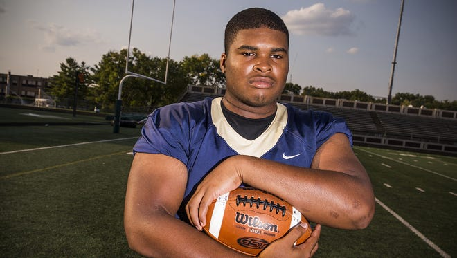 """Senior Cathedral lineman Emil Ekiyor: """"We have to put ourselves in a cave and focus on ourselves."""""""