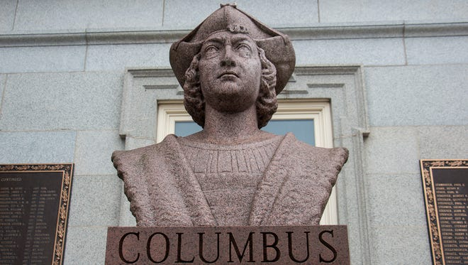 A Christopher Columbus statue sits at the top of the steps at the old York County Courthouse in Downtown York.