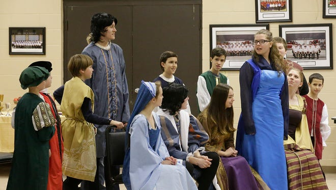 "Children rehearse ""The Prince and the Pauper"" on Feb. 28, 2018, at the Eden Community Center. Lady Elizabeth stands to speak her mind at the Royal Court in London, England, and the Court waits for the Prince's final decision on an important matter. From left, the Royal Court are: Michael Doll, Joshua Switzer, Russel Murphy, Samuel Schmidt, Kayla Doll, Christian Steffes, Isaac Steffes, Lily Hernandez, Caleb Steffes, Sara Titel, RB Murphy, Jenna Soldner and Seth Steffes. The Homeschool Performing Arts Club will present the play March 16 and 17."