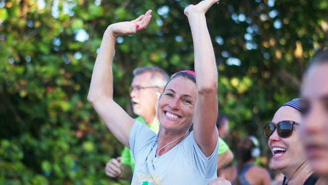 A participant enjoys last year's Run 4 The Sea along Highway A1A in Juno Beach.