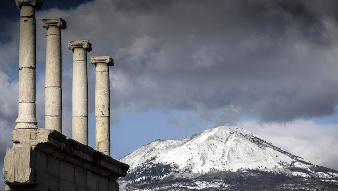 The snow-covered peak of Mount Vesuvius volcano is seen from the archaeological excavations of Pompeii in Naples, southern Italy, in January 2017.