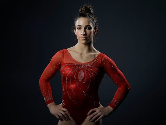 Gymnast Aly Raisman poses for photos at the 2016 Team