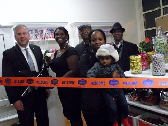 Nivanno Services, 137 E. Main St., Somerville, offers a full slate of event planning services and related products. Pictured from left to right are Somerville Mayor Brian Gallagher, Nivanno Services owner Gladys Zoker, her father, Samuel Zoker, Antoinette Ray holding Noah Zoker and Pastor William of Resurrection Assembly of God Church in Newark.