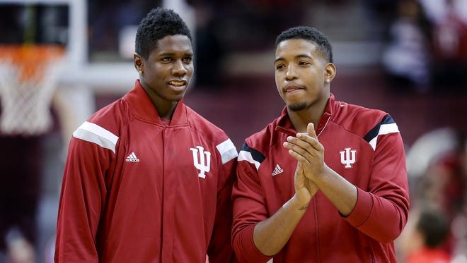 Hanner Mosquera-Perea,left, and Devin Davis,right, watch their teammates warmup to play the Buckeyes. The Indiana Hoosiers lost to the Ohio State Buckeyes 82-70 Sunday, January 25, 2015, afternoon at Value City Arena, in Columbus, Ohio.