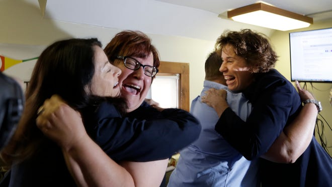 Attorney Dana Nessel reacts with April DeBoer and Jayne Rowse of Hazel Park and Carole Stanyar as they react to the decision of the U.S. Supreme Court to outlaw  bans on same-sex marriage.
