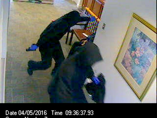 Security cameras show two heavily disguised men who