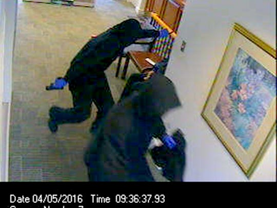 Security cameras show two heavily disguised men who robbed the M&T Bank, 903 State Drive, in South Lebanon Township.