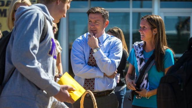 Principal Jim Gmelich chats with parent Brigid Kiley (right). Gmelich expects an enrollment rebound in the next few years.