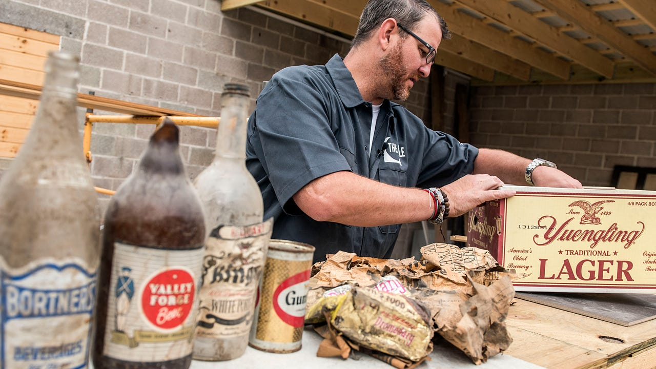 Tom Hufnagle, the owner of The Winner's Circle in Hanover, has found some interesting artifacts while adding on the patio to the bar. Bottles, pipes and papers, which date back 50 years are just some of the interesting things that filled the walls.
