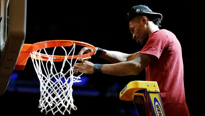 South Carolina forward Chris Silva (30) cuts down the net after South Carolina beat Florida 77-70 in the East Regional championship game of the NCAA men's college basketball tournament, Sunday, March 26, 2017, in New York. (AP Photo/Julio Cortez)