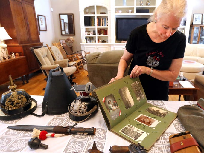 Helen Yatuzis shows off some of the World War I items that she and her father have collected over the years, including an album of field posts or post cards, at the home of Linda Brendle on Thursday July 24, 2014. Yatuzis' Uncle served in WWI in the Prussian Cavalry.