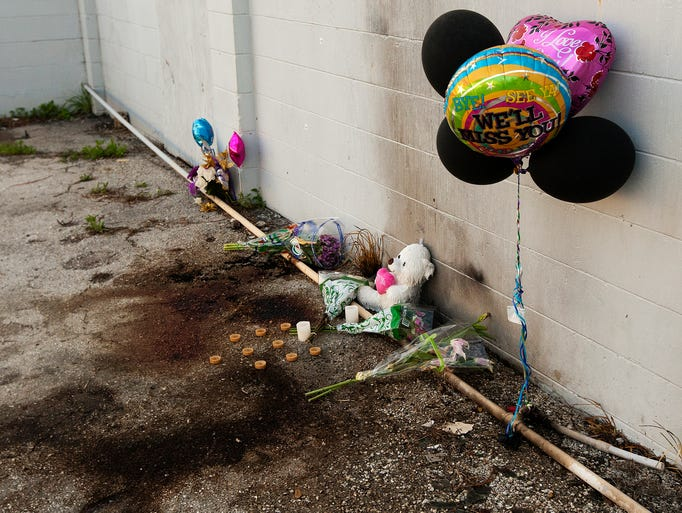 Candles, balloons, flowers and stuffed animals adorn the site Friday, where according to the Fort Myers Police Department, a transgender person identified as Eddie James Owens, 31, was found dead Thursday behind a garbage container at Budget Truck Rental in Fort Myers. Police said Owens was found burned to death at 2807 Fowler Street. The death has been ruled a homicide.