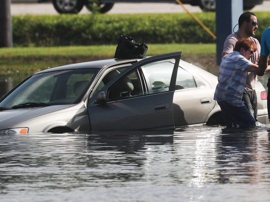 Mary Beekman, a resident of Island Park in south Lee County was rescued from her vehicle by three good samaritans on August 29, 2017 who include Bryan Heath, Andrew Kerinuk and John Joshua after her car started floating in flood waters on Island Park road on Tuesday. She was trying to make it back to her home after getting out of the flooded neighborhood in the morning.