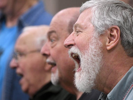 Dan Strader and other members of the Fun Center Chordsmen rehearse Monday evening at the First Congregational Church.