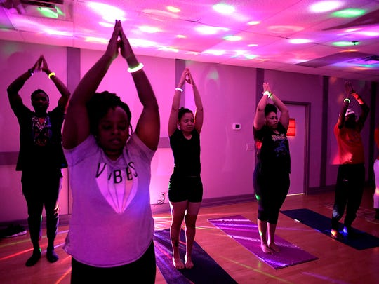 About 20 people participated in a Black Panther Yoga/Vinyasa class at Nashville Ballroom and Company on Saturday, Feb 18, 2018.