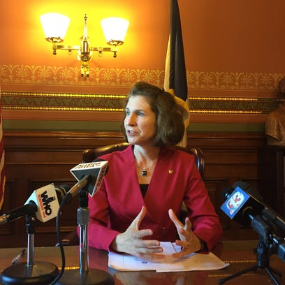 State Auditor Mary Mosiman talks with reporters Monday,