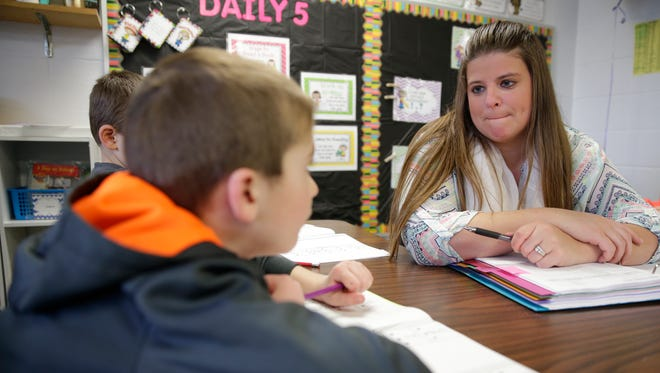 Golden Apple teacher Ashley Post of Wrightstown Elementary School works with a student in her class March 23,  2016.