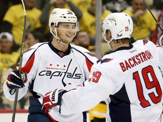 Capitals wing Andre Burakovsky (65) celebrates his