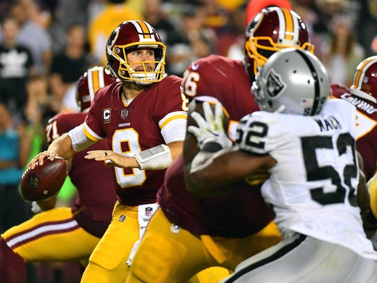 Sep 24, 2017; Landover, MD, USA; Washington Redskins quarterback Kirk Cousins (8) drops back to pass against the Oakland Raiders during the second half at FedEx Field.