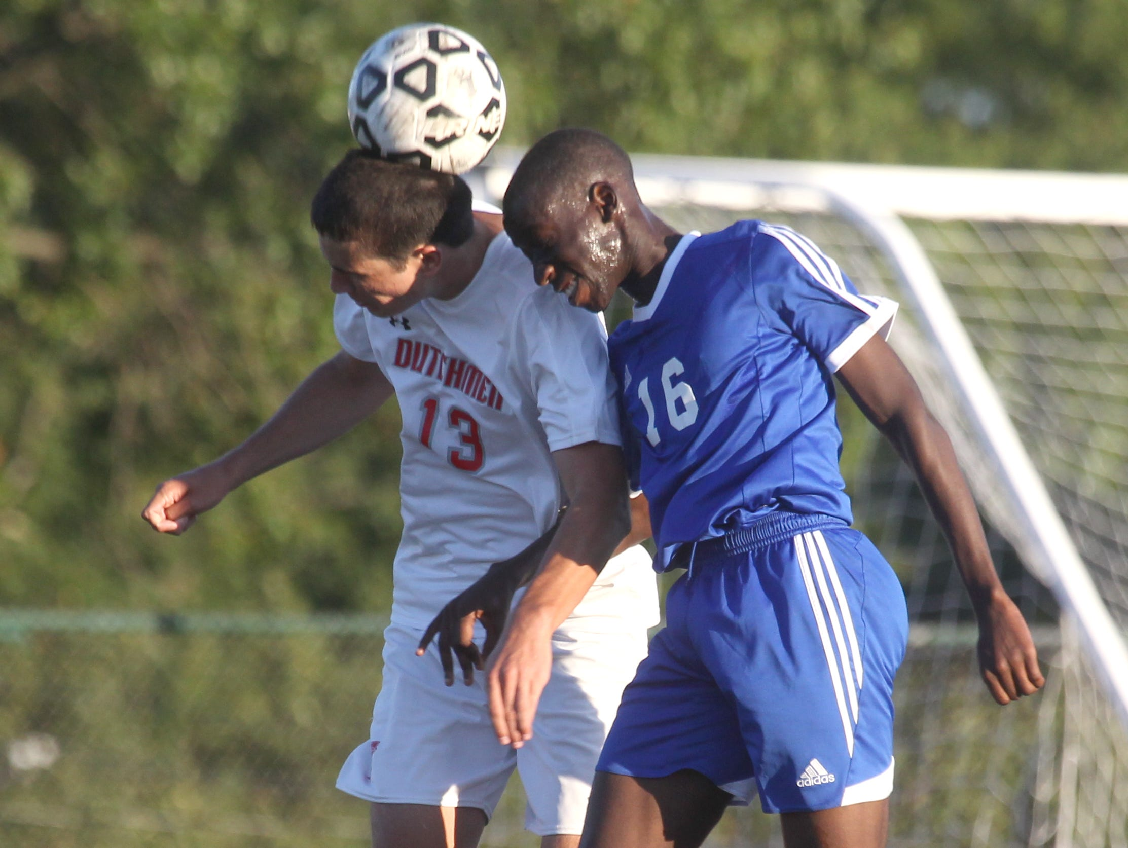 Tappan Zee's Chris Mulqueen, left, heads the ball next to Pearl River's Craig McDonald during a game at Tappan Zee Sept. 24, 2015. Pearl River won1-0.